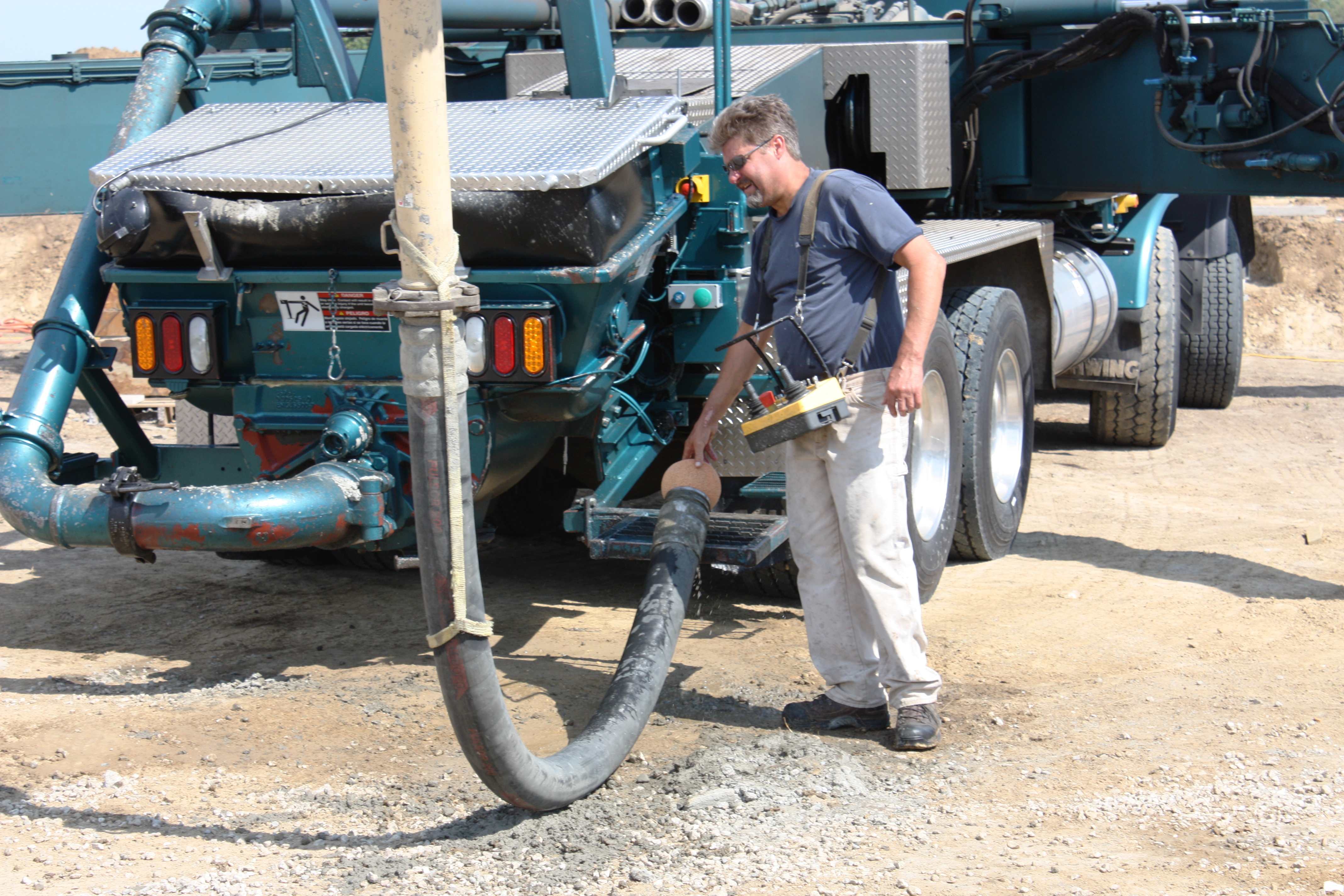 Full Revolution Farm Cleanup of Pumping Truck after concrete pour
