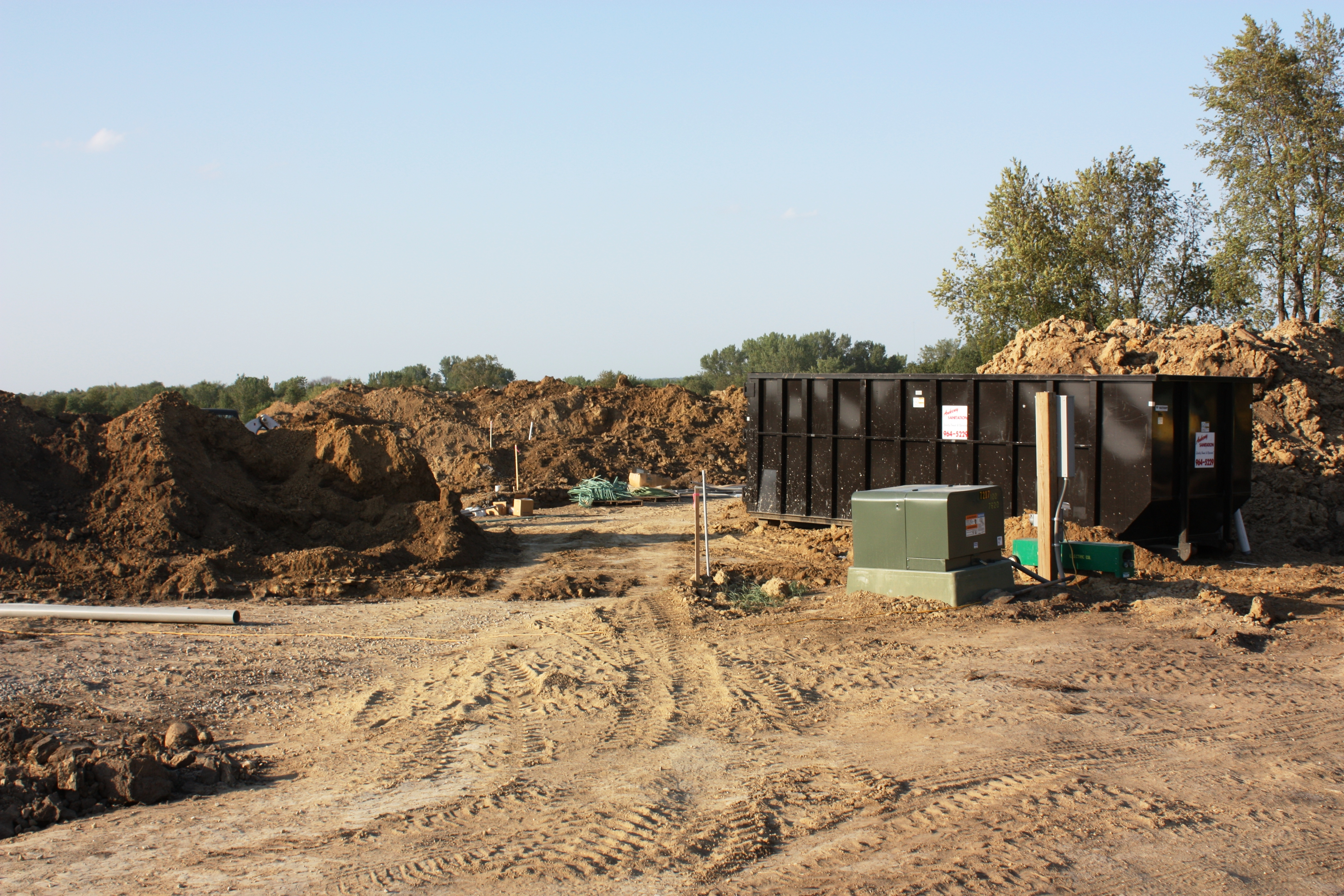 Full revolution farm Electrical and Water Line Trenches are Backfilled and Compacted