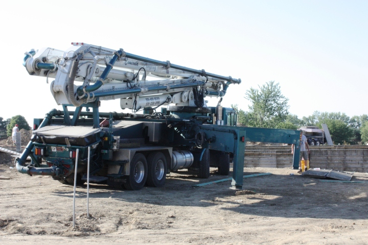 Full Revolution Farm Pumping Truck setting up for wall pour